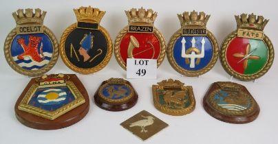 Nine cast ship's crest plaques plus a ca