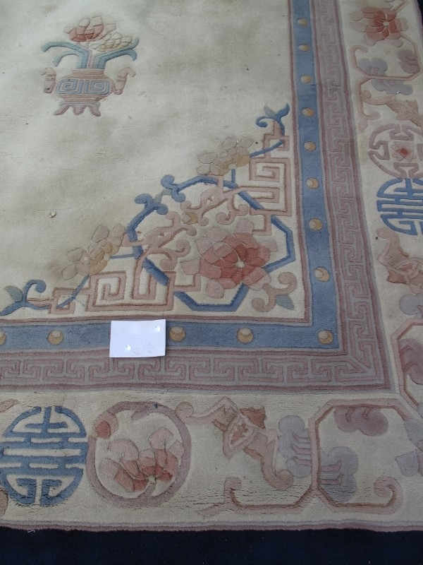 A large 20th century Chinese carpet on c