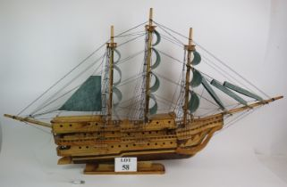 A large wooden scale model of a three ma