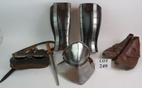 A medieval re-enactment pair of leather and steel leg guards, a steel throat protector,