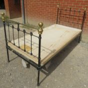 A Victorian wrought iron & brass single bed by Seventh Heaven, with polished brass ball finials.