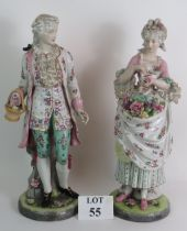 A large pair of hand decorated Continental porcelain figures in 18th Century dress, tallest 56cm. No
