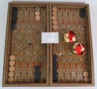 An inlaid Damascus Ware games box with backgammon board interior and chess board exterior. Bone