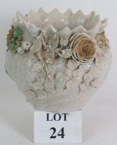 An early 20th Century Belleek porcelain jardinière with ornate applied flowers and foliage. 2nd