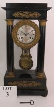 A French Empire mantel clock by A Blant, Paris with ebonised case and gilt bronze mounts with an 8