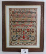 A 19th Century Scottish needlework sampler in oak frame, signed Annie Morrison Cairnbanno May 21st