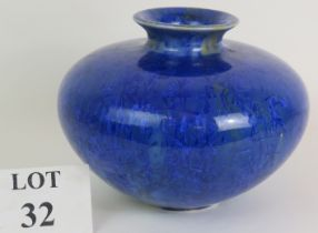 A large squat blue studio pottery vase by Tony Lamerick with overall seed head decoration. Marked