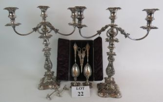A pair of ornate Sheffield plate three branch candelabra, a cased set of silver plated grape