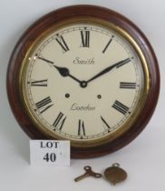 An early 20th Century Smith of London station style striking wall clock in oak case. Diameter