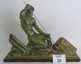 An early 20th Century French Verdigris plaster sculpture in the industrialist style of a male figure