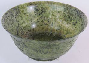 A large Chinese carved spinach Jade bowl, 27cm in diameter, 12cm tall. Very finely carved to a