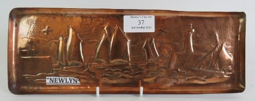 An Arts and Crafts Newlyn copper repousse tray with scene of sailing boats in a harbour. Stamped