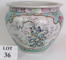 An antique Chinese porcelain Jardinière decorated in the Canton style on a light blue ground. Signed