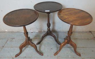 A trio of Edwardian mahogany circular tripod wine tables. 50cm high x 30cm wide x 30cm deep (