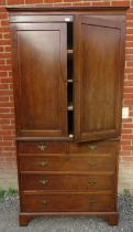 A Regency inlaid and crossbanded mahogany linen press, with three slides, over a chest base