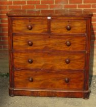 A Victorian mahogany chest of drawers, two short over three long graduated cock beaded drawers, with