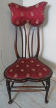 A turn of the century Art Nouveau bedroom occasional chair with unusually shaped back rest and
