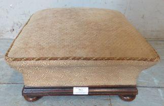 A Victorian oak framed square footstool on bun feet. 18cm high x 34cm wide x 34cm deep (approx).