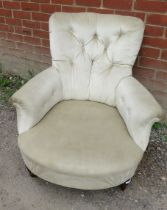 A Victorian low bedroom armchair upholstered in a cream buttoned velvet, raised on tapering turned