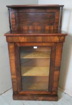 A Victorian rosewood chiffonier cabinet with glazed door opening onto two gold velvet wrapped