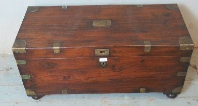 A 19th century oak brass bound campaign chest with internal candle holder box, raised on bun feet.