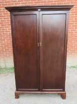 An Edwardian Georgian revival mahogany double wardrobe of small proportions. 170cm high x 109cm wide