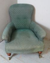 A 19th century Howard style low armchair by Hindley & Sons of Oxford Street, raised on tapering