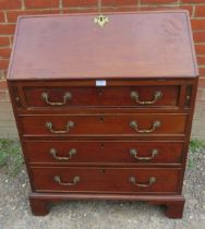 A 19th century mahogany bureau of small proportions, the fitted interior with central document safe,