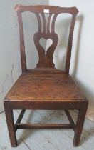 An 18th century oak hall chair with a shaped & pierced back splat depicting a love heart, possibly