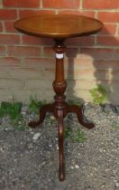 An Edwardian Regency revival mahogany circular wine table with a dished top over a fluted column