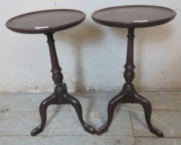 A pair of diminutive Edwardian mahogany wine tables with dished tops, baluster columns and tripod