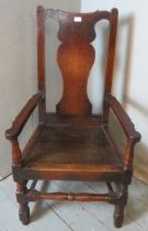 An early 18th century oak carver hall chair of excellent colour and patina. 114cm high x 60cm wide x