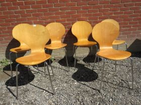 A set of six Fritz Hansen design stacking pressure treated chairs with chrome legs. Condition