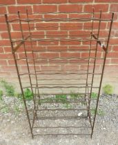 A vintage wrought iron wine rack with aged patina. 104cm high x 54cm wide x 45cm deep (approx).