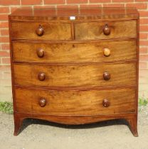 A George III now fronted mahogany chest of two short over three long graduated cock beaded drawers