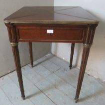 An Edwardian Regency revival 'plum pudding' mahogany envelope 'whist' table with gilt metal
