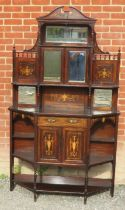 An Edwardian rosewood marquetry inlaid side cabinet with bevelled mirror panels, single drawer and