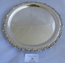 An antique silver card tray with acanthus leaf decorated rim. Hallmark rubbed and indistince. Weight