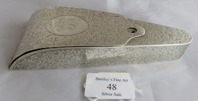 A lovely silver C19th engraved pattern scissor case containing 2 pairs of scissors (not silver).