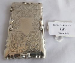 A silver card case with hinged lid of foliate pattern and embossed scrolled edge. Birmingham 1916,