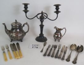 An ornate late Victorian silver plated teapot and jug, a two branch candelabra and a quantity of