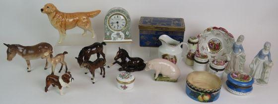 A collection of seven Beswick pottery animals, a Wedgwood bone china clock, Copeland gilt