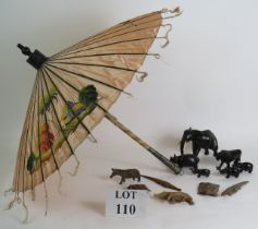 A vintage Far Eastern hand decorated silk parasol with white metal handle and a quantity of hand