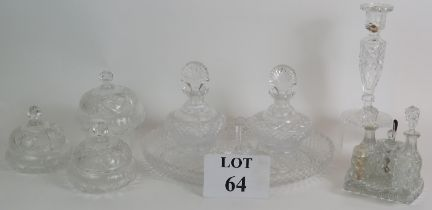 A four piece cut crystal dressing table set, three similar covered jars, a cut glass candlestick and