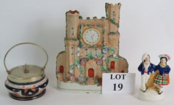 A 19th Century Staffordshire flat back castle, a similar Staffordshire figure and nickel mounted