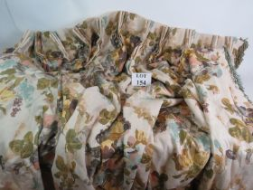 A large pair of good quality fully lined curtains with a pastel floral print. Length 210cm. Width