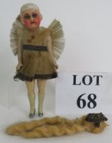 A small antique German porcelain headed doll by Armand Marseille in period angel dress with moveable