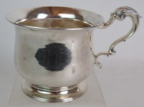 A George III silver half pint mug of squat baluster form with acanthus leaf scroll handle and
