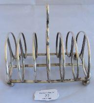 A large Georgian silver toast rack on ball feet, Sheffield 1824, maker John and Thomas Settle.