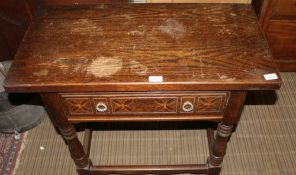 A REPRODUCTION OAK FINISHED RECTANGULAR TOPPED SIDE TABLE with single frieze drawer, over baluster